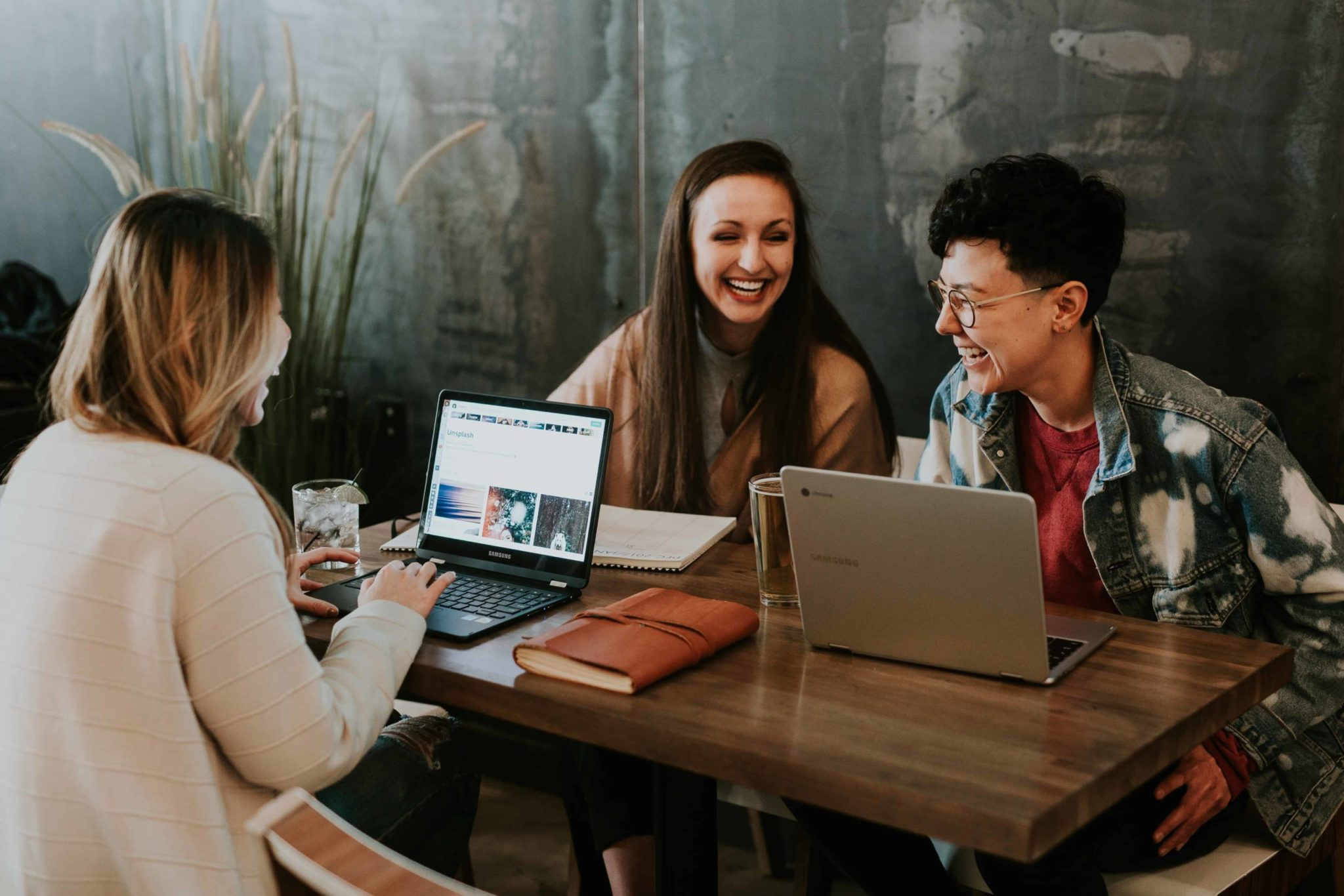 3 Steps to Build Your Culture Marketing Strategy - Employees talking with laptops - Green Loop Marketing Indianapolis